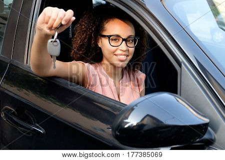 Happy Young Woman Seated In New Car