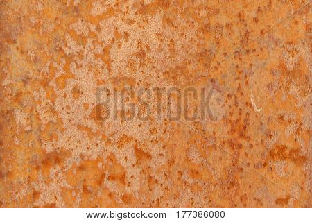Rust on metal as a background. Orange rusty wall texture.