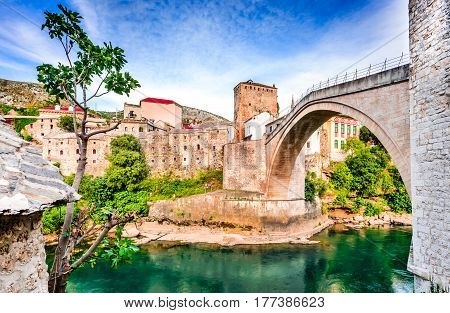 Mostar Bosnia and Herzegovina. Morning sun on Nerteva River and Old City of Mostar with Ottoman Mosque