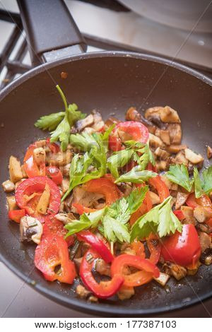Mushrooms And Fresh Sweet Red Pepper In The Pan
