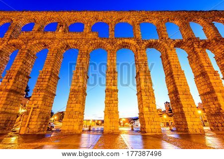 Segovia Spain. Plaza del Azoguejo and the ancient Roman Aqueduct from 1st century AD of Roman Empire.
