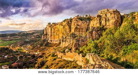 Panoramic View Of The Old Town Of Ronda, One Of The Famous White Villages, At Sunset In The Province