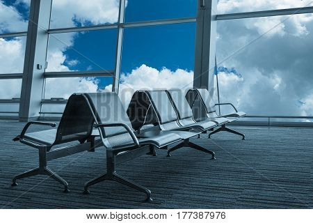 Seats view from unrecognisable airport hall. Travel image
