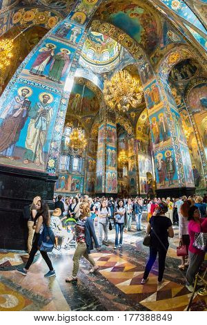 Church Of The Savior On Spilled Blood. Numerous Tourists Admire The Mosaics Of The Cathedral.