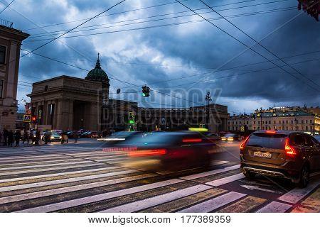 ST. PETERSBURG RUSSIA - JULY 13 2016: Kazanskiy Cathedral in Saint Petersburg in Russia blurred traffic under stormy skies