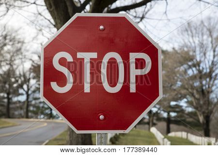 A red and white stop road sign