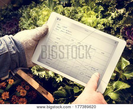 Man Holding Tablet Control Crop Plan List