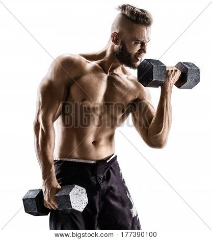Strong man doing exercises with dumbbells at biceps. Photo of muscular male with naked torso on white background. Strength and motivation