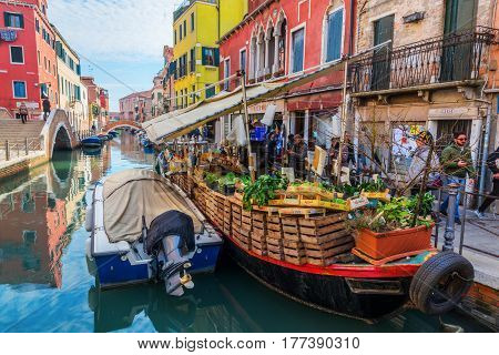 Canal With A Market Boat In Venice, Italy