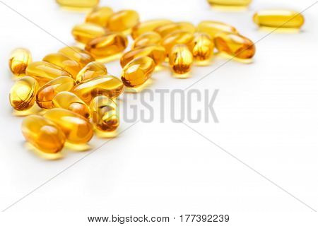 Many capsules Omega 3 on blurred background. Copy space high resolution product. Health care concept