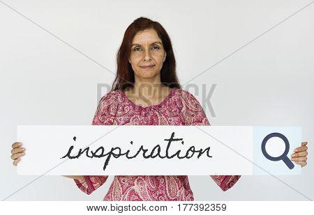 Mature woman holding inspiration banner