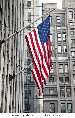 Two American hanging off a New York City building
