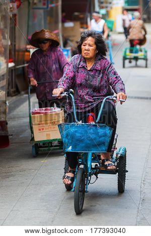 Native Woman With Bicycle In Tai O, Lantau Island, Hong Kong