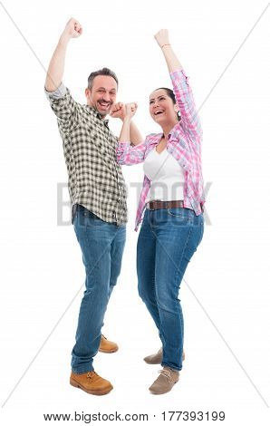 Joyful Couple Celebrating Triumph And Raising Hands Up