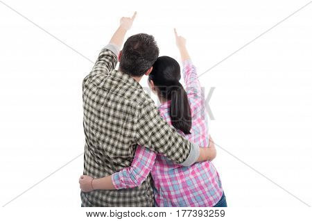 Back View Of Young Couple Pointing At Something