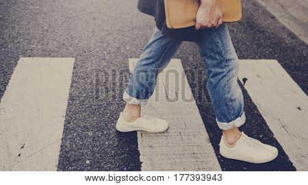 Young man walking crosswalk commuter lifestyle