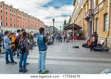 People Enjoy The Show Of Buskers On The Embankment Of Griboyedov Canal, St. Petersburg, Russia