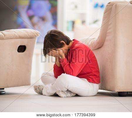Children inside interior of modern home on ground