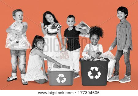 Diverse Group Of Kids Recycling Garbage