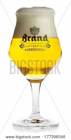 GRONINGEN, NETHERLANDS - MARCH 20, 2017: Glass of Dutch Brand Saison beer isolated on a white background
