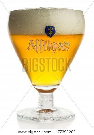 GRONINGEN, NETHERLANDS - MARCH 20, 2017: Glass of Belgian Affligem Blonde beer isolated on a white background