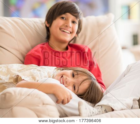 Child inside interior of modern home sitting on sofa