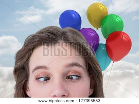 Digital composite of Funny Woman with Balloons Playing with her eyes against a sky background