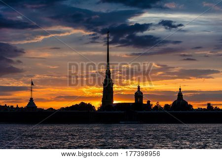 ST. PETERSBURG RUSSIA - JULY 13 2016: Colorful sunset over Peter and Paul Cathedral St. Petersburg Russia