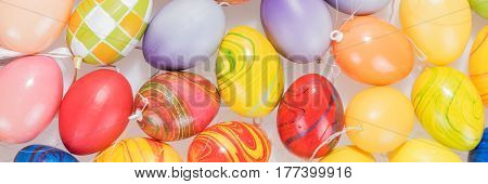 Many colorful Easter eggs, colored Easter background
