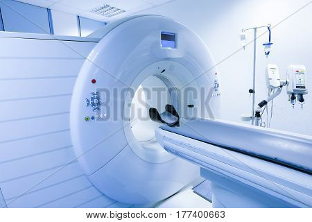 CT (Computed tomography) scanner in hospital laboratory. Health care medical technology hi-tech equipment and diagnosis concept with copy space.