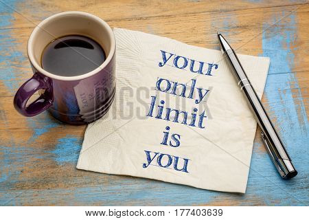 Your only limit is you - inspirational handwriting on a napkin with a cup of espresso coffee