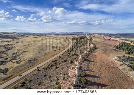 aerial landscape of northern Colorado foothills near Livermore with highway 287 and sandstone quarry