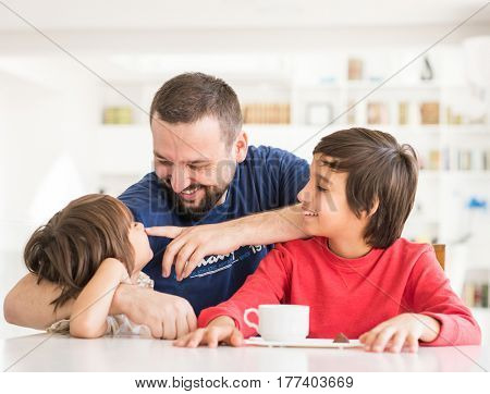 Happy father and son at modern new white home