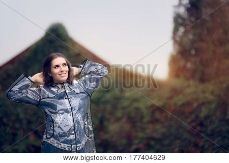 Happy Woman in Raincoat Enjoying the Rain