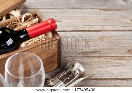 Red wine bottle and glasses on wooden table. View with copy space