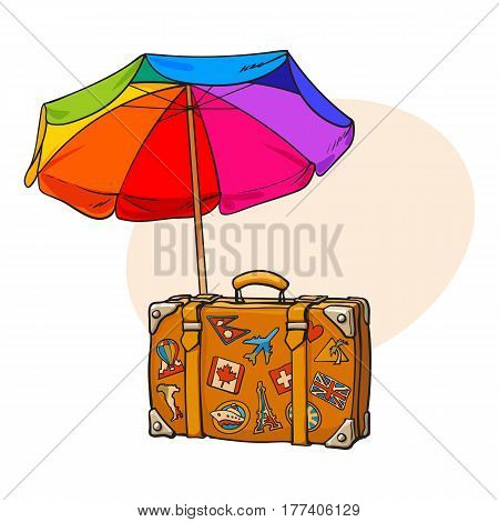 Rainbow colored, open beach umbrella and travel suitcase with luggage stickers, sketch vector illustration with place for text. Hand drawn beach umbrella and suitcase with travel stickers