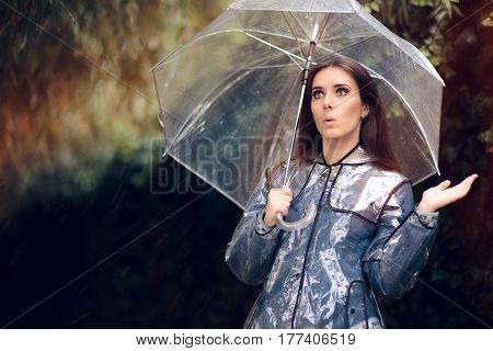Surprised Woman in Raincoat with Transparent Umbrella