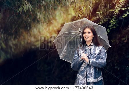 Happy Woman in Raincoat with Transparent Umbrella