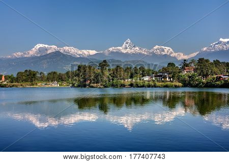 View at Annapurna mountain range and its reflection in Phewa lake in Pokhara Nepal