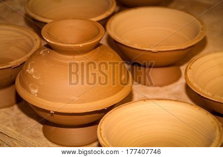 A collection brown homemade of clay bowls