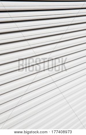 Stack of white plasterboard panels. Construction industry new home concept and textured background.