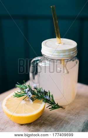 Refreshing cocktail from grapefruit and rosemary in a jar