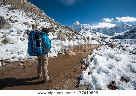 Trekker approaching Amadablan mount in Khumbu valley on a way to Namche Bazar