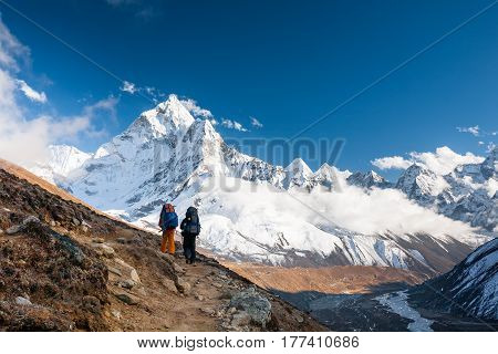 Trekkers approaching Amadablan mount in Khumbu valley on a way to Namche Bazar