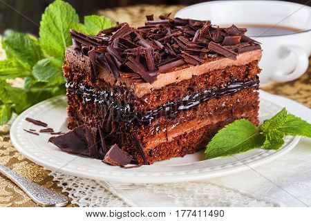 Chocolate cake slice, layers, cream, chocolate chips, still life exquisite mint