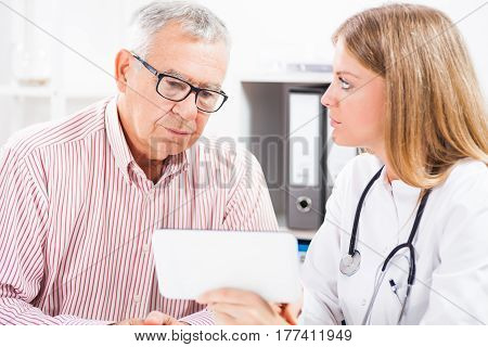Doctor is showing medical test results to her patient.
