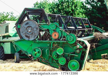 Reel in the green combine harvester. Part of the agricultural machine.