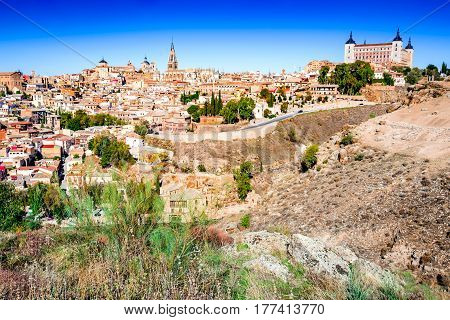 Toledo Spain. Alcazar and the ancient city on a hill over the Tagus River Castilla la Mancha medieval attraction of Espana.