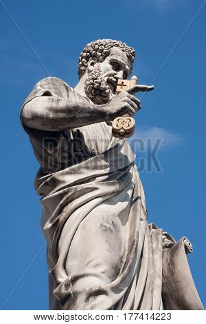 Vatican city - MARCH 22 2011. Statue of Saint Peter in Saint Peter's Square blue sky background.