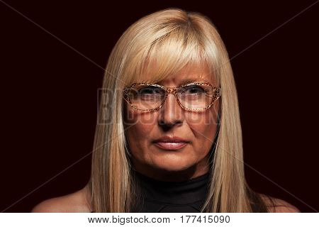 Serious woman wearing glasses portrait on isolated background